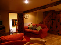 Pudding Pie Barn, Wigley, Nr. Baslow, Derbyshire -  Lounge with Door to Downstairs Bedroom
